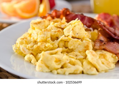 Closeup of scrambled eggs with crispy bacon