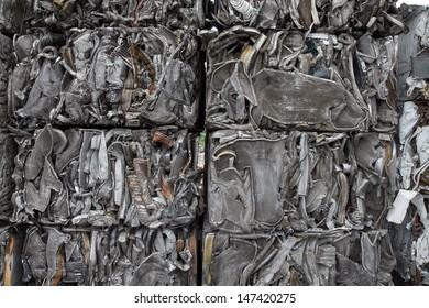 Closeup of scrap metal bales bundled for recycling