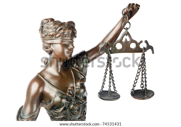 Closeup of a sculpture of Themis, mythological Greek goddess, symbol of justice, blind and holding empty balance in her hand, isolated on white background