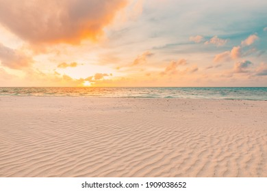 Closeup sea sand beach. Panoramic beach landscape. Inspire tropical beach seascape horizon. Orange and golden sunset sky calmness tranquil relaxing sunlight summer mood. Vacation travel holiday banner