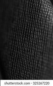 Closeup of seamless black leather texture.