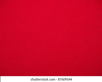 closeup of seamless red knitted fabric texture