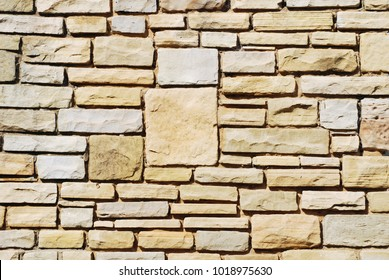 Closeup of section of a stone wall of house