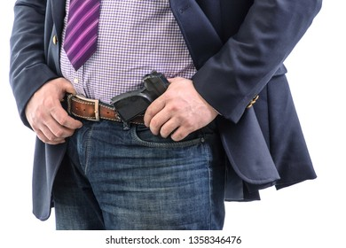 Closeup security agent in business suit with hand gun attached on belt. isolated on white background