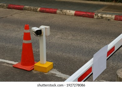 Closeup of security camera installed on upright post fixed to street at security checkpoint for vehicle
