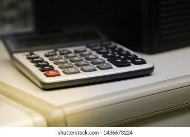 closeup and selective focus calculator on white table