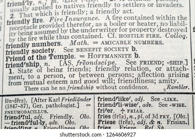 A close-up selective focus on the definition of Friendship in Webster's New International Dictionary of the English Language Second Edition unabridged  printed 1955
