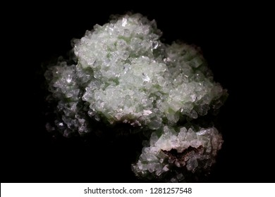 Closeup selective focus of sharp natural crystal stone mineral shapes against black background.