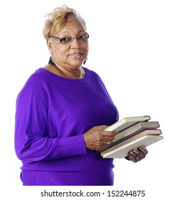 Closeup of a senior adult woman carrying the books she loves to read.  On a white background.