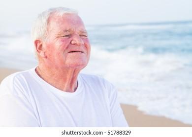 closeup of senior citizen man on beach