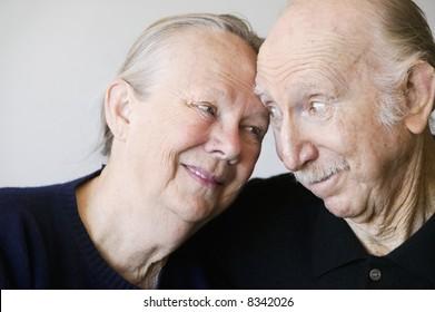Close-up of senior couple embracing