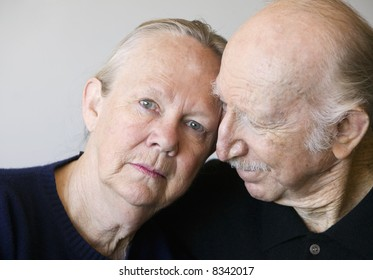 Close-up of senior couple focusing on worried woman