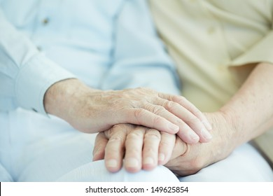 Close-up of senior male hands in hand of his wife