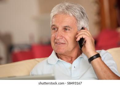 Closeup of senior man talking on mobile phone