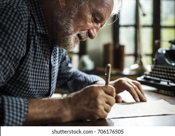 Closeup of senior man writing letter