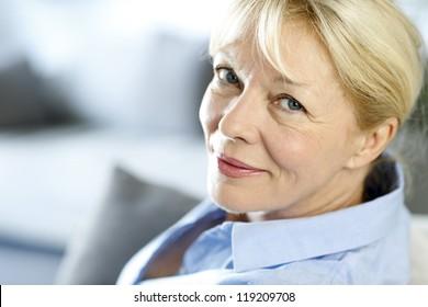 Closeup of senior woman with blue shirt