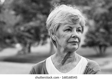 Close-up of a senior woman looking away at the park