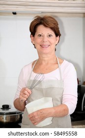 Closeup of senior woman standing in kitchen