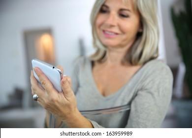 Closeup of senior woman using smartphone