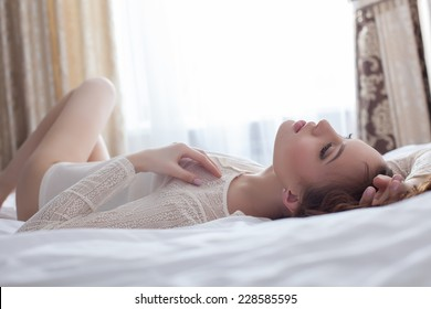 Close-up of sensual woman lying on bed