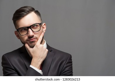 Close-up - serious businessman or manager posing on gray background. Copyspace