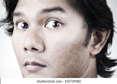 closeup  serious Thai men face