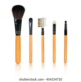closeup set of a blush brushes with reflection on an isolated white background