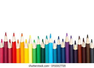 Close-up of set of colorful pencils on white background with copy space