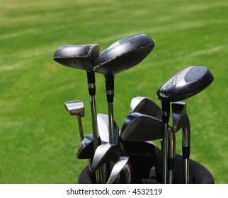 Close-up of a set of golf clubs.