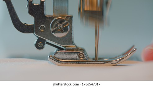 Close-up of a sewing machine foot, sew a seam.