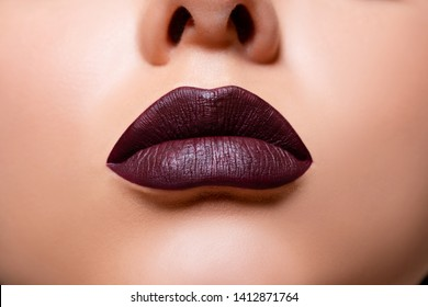 Closeup Sexy burgundy Lips. Macro lips nail burgundy color makeup campaign cosmetics. Lip Makeup.  Beauty. Volume Lips. cherry plump  lips - Image
