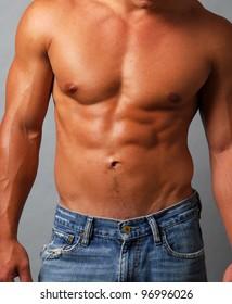 Closeup of a sexy muscular man, shirtless, abs, pecs and biceps