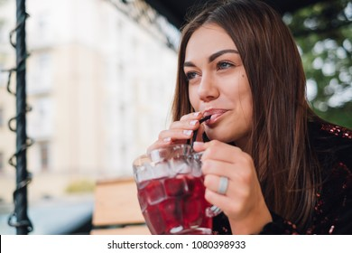 Closeup of a sexy woman drinking from a drinking straw fresh summer drink