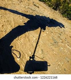 Close-Up Shadow of Man Hiking