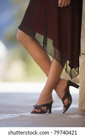 Close-up of shapely legs in high-heeled shoes.