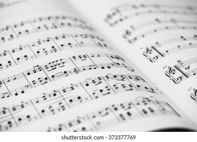 Closeup of Sheet Music. Musical Notes with Selective Focus.