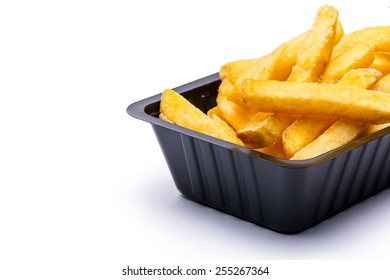 close-up from a shell of french fries isolated on white