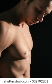 Closeup of a shirtless man's defined chest
