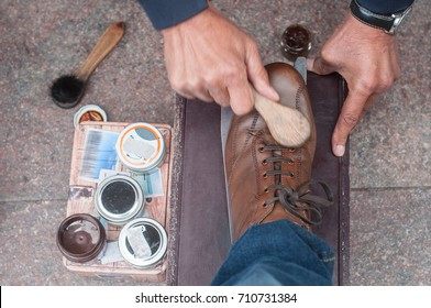 closeup of shoe shine  in the street on brown leather shoes