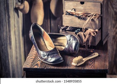 Closeup of shoemaker workshop with shoes, tools and laces