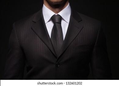 closeup shoot of businessman on dark background