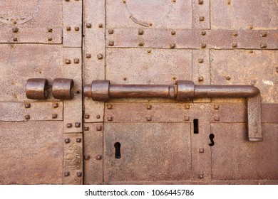 Close-up shot of an ancient latch on an old rusty door
