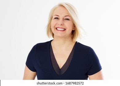 Closeup shot of a beautiful blonde middle-aged woman smiling heartily, cropped image.