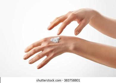 Closeup shot of beautiful female hands with cream