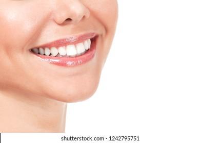Closeup shot of beautiful female smile, isolated on white background