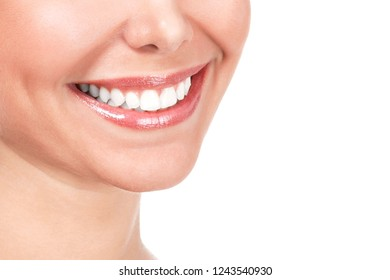 Closeup shot of beautiful female smile, isolated on white background