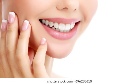 Closeup shot of beautiful female smile, white background.