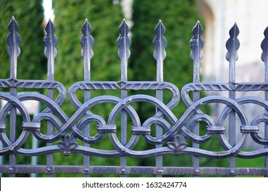 A closeup shot of the beautiful patterned details of an iron fence
