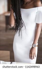 Close-up shot of beautiful white dress on afroamerican woman.