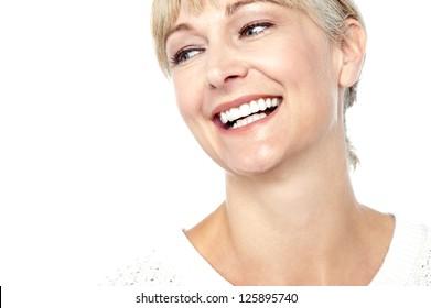 Closeup shot of a beautiful woman smiling heartily, cropped image.